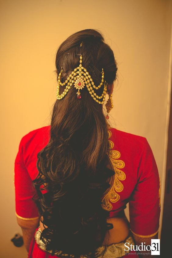 bride in red, tied and loose bun