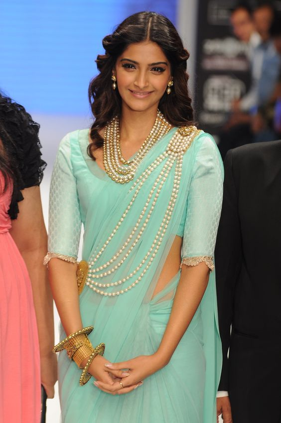 Sonam kapoor with tied and loose bun