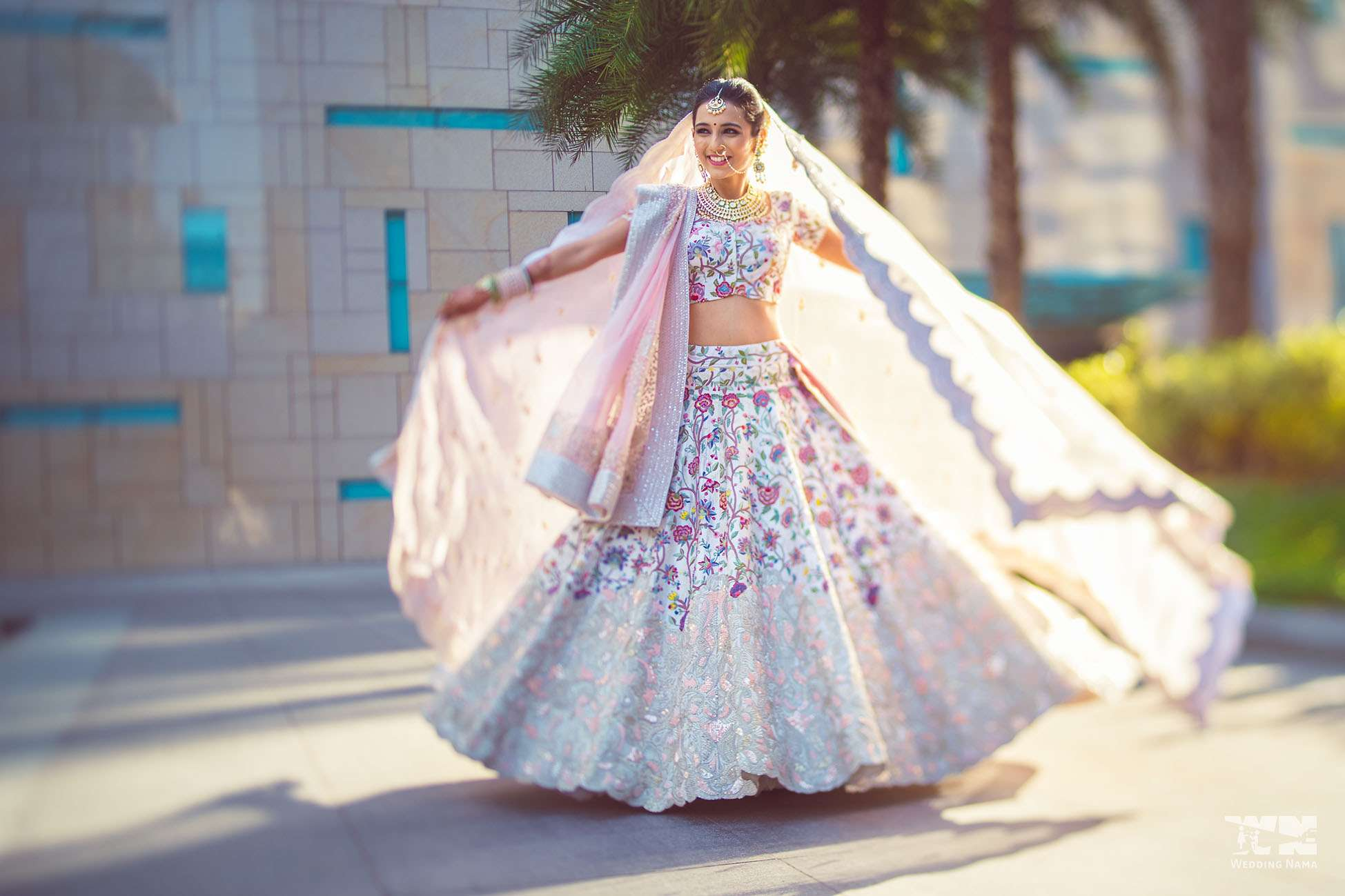 Masoom Minawala | Twirling Bride in Blush Pink Pristine White Anamika Khanna Lehenga with Silver Jaal Work and Floral Embroidery | 11 Unique Lehenga Hues That Will Make You Ditch The Usual Red | FunctionMania