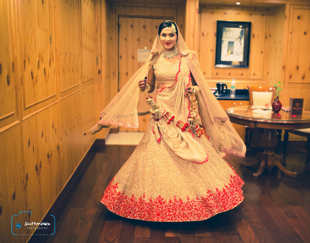 Twirling bride in off-white gold sequence lehenga with red floral embroidery Turquoise lehenga with gota leaf work and golder top | 11 Unique Lehenga Hues That Will Make You Ditch The Usual Red | FunctionMania