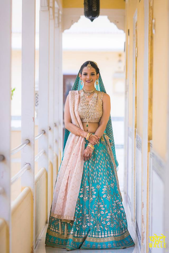 Turquoise lehenga with gota leaf work and golder top | 11 Unique Lehenga Hues That Will Make You Ditch The Usual Red | FunctionMania