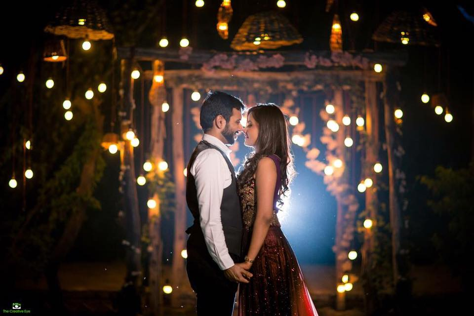 Very romantic pre wedding photoshoot of a couple at night with fairy lights and giving diwali feel with bulbs and lights | Photo Paradise | 5 Spectacular Photo Shoot Locations in Delhi NCR | FunctionMania