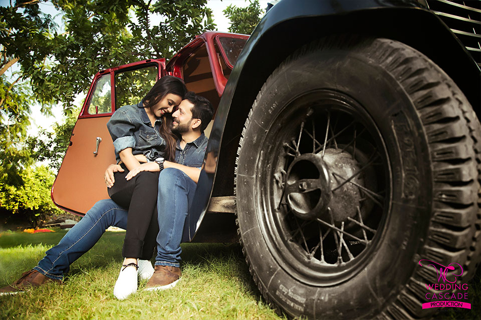 Couple photoshoot in red vintage car and green backdrop | Studio Future Forward | 5 Spectacular Photo Shoot Locations in Delhi NCR | FunctionMania