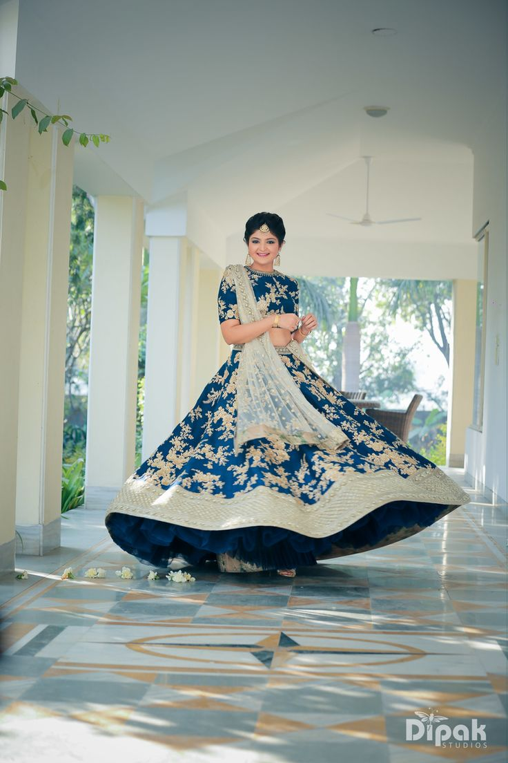 Twirling Bride in Royal Blue Lehenga With Gold Floral Work | 11 Unique Lehenga Hues That Will Make You Ditch The Usual Red | FunctionMania
