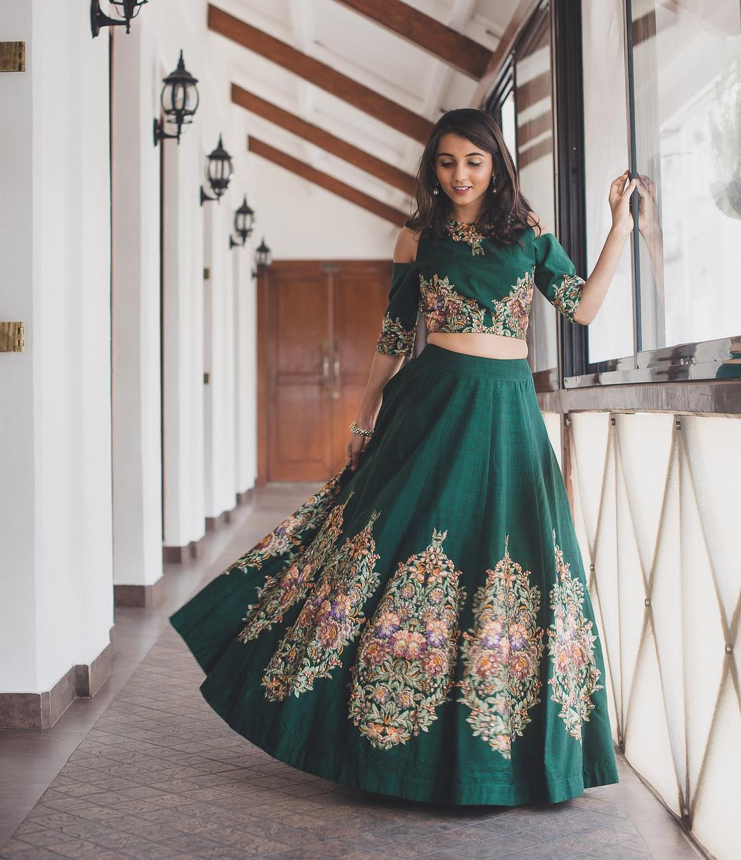 Bride in Bottle Green Crop Top and Skirt with Patchwork Embroidery | 11 Unique Lehenga Hues That Will Make You Ditch The Usual Red | FunctionMania