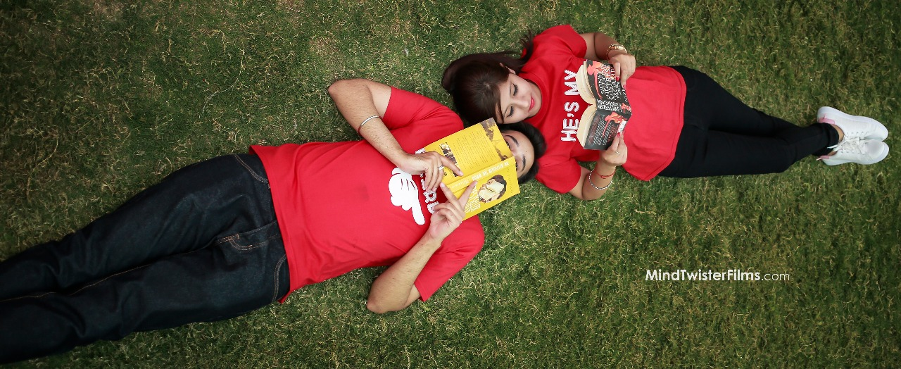 Romantic pre wedding photoshoot of a couple reading books together | Your Dream Location | 5 Spectacular Photo Shoot Locations in Delhi NCR | FunctionMania