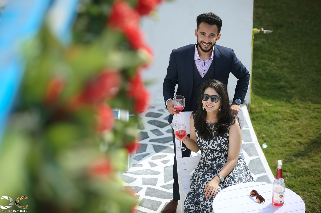 Couple drinking wine with sunglasses on summer photoshoot | Your Dream Location | 5 Spectacular Photo Shoot Locations in Delhi NCR | FunctionMania