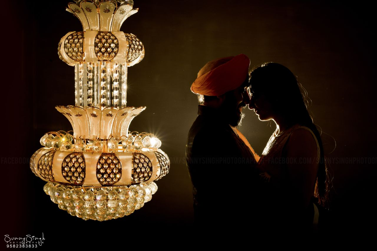 Sikh Couple Pre Wedding Photoshoot wearing orange turban and beautiful chandelier | 5 Spectacular Photo Shoot Locations in Delhi NCR | FunctionMania