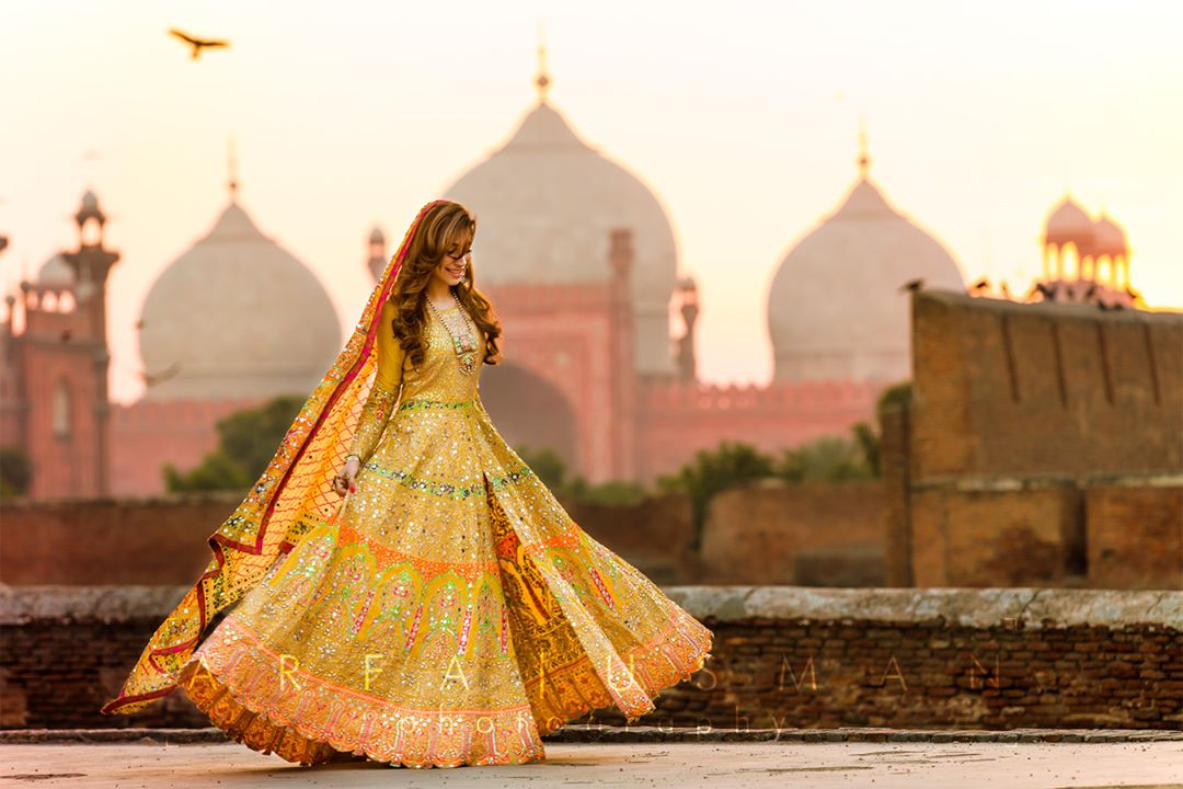 Twirling Bride in Mustard Anarkali Styled front open lehenga with yellow mirror work and peach border Turquoise lehenga with gota leaf work and golder top | 11 Unique Lehenga Hues That Will Make You Ditch The Usual Red | FunctionMania