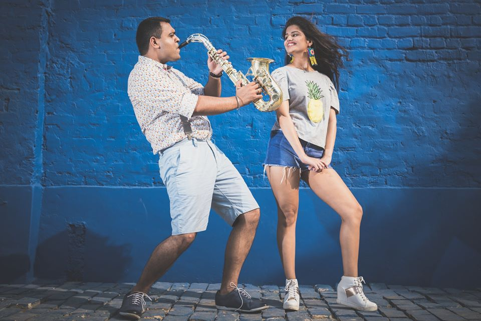Romantic Couple Pre Wedding Photoshoot with the groom blowing the trumpet at Picture Destination | 5 Spectacular Photo Shoot Locations in Delhi NCR | FunctionMania