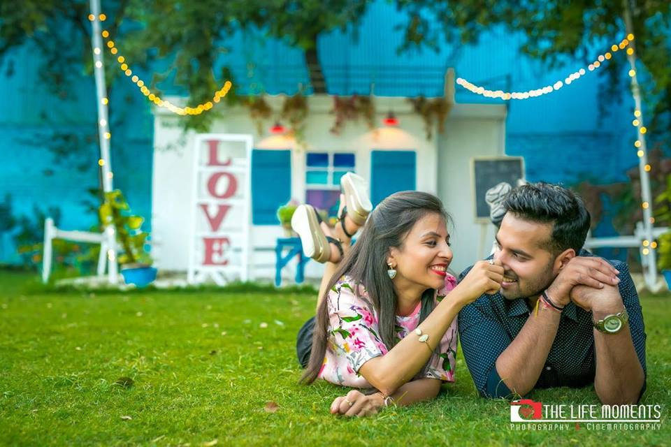 Romantic couple photoshoot laying in the grass at Picture Destination | 5 Spectacular Photo Shoot Locations in Delhi NCR | FunctionMania