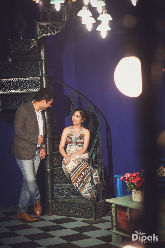 Magical couple photoshoot at stairs with light chandeliers and at the perfect location kundali | 5 Spectacular Photo Shoot Locations in Delhi NCR | FunctionMania