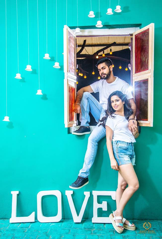 quirky and fun pre-wedding photoshoot with couple twinning by wearing white t-shirt and blue denim bottoms at the perfect location kundali | 5 Spectacular Photo Shoot Locations in Delhi NCR | FunctionMania