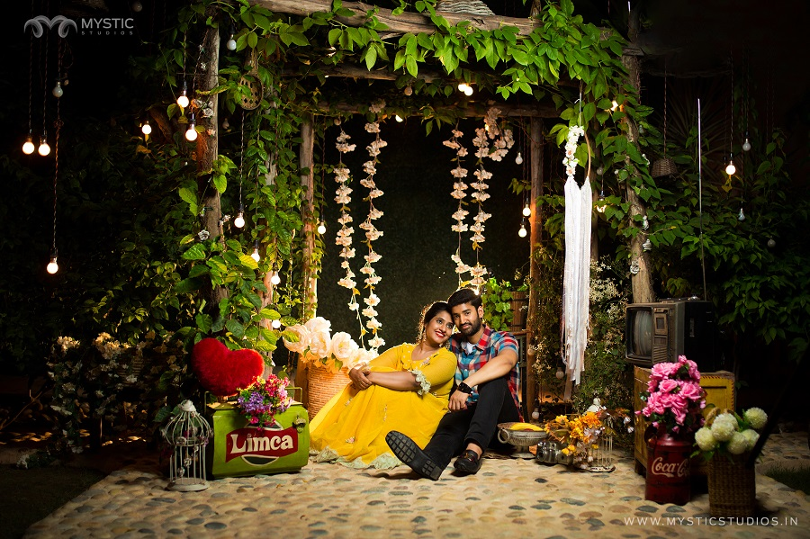 Beautiful Romantic Pre wedding photoshoot with bride in yellow dress with garden setting and flower backdrop | Photo Paradise | 5 Spectacular Photo Shoot Locations in Delhi NCR | FunctionMania