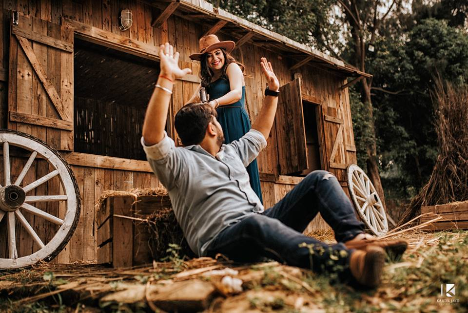 cowboy couple photoshoot with country style location and backdrop at Studio future forward | 5 Spectacular Photo Shoot Locations in Delhi NCR | FunctionMania