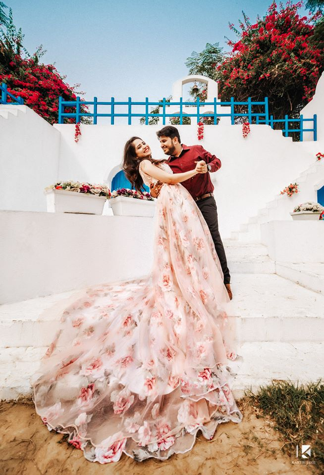 Romantic pre wedding photoshoot of a couple with bride wearing a beautiful printed floral gown and groom wearing a wine red shirt | Studio Future Forward | 5 Spectacular Photo Shoot Locations in Delhi NCR | FunctionMania