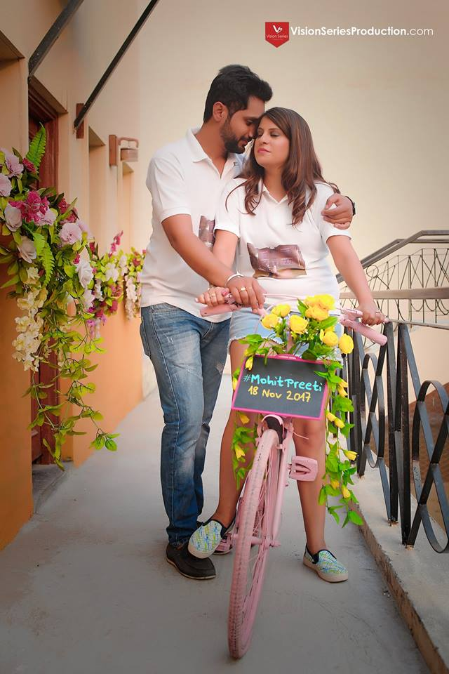 Romantic Pre Wedding Photoshoot, Save the Date at Your Dream Location with Flower Decoration and Pretty Pink Bicycle prop Pre Wedding Photoshoot of couple with fairy lights at Your Dream Location | 5 Spectacular Photo Shoot Locations in Delhi NCR | FunctionMania