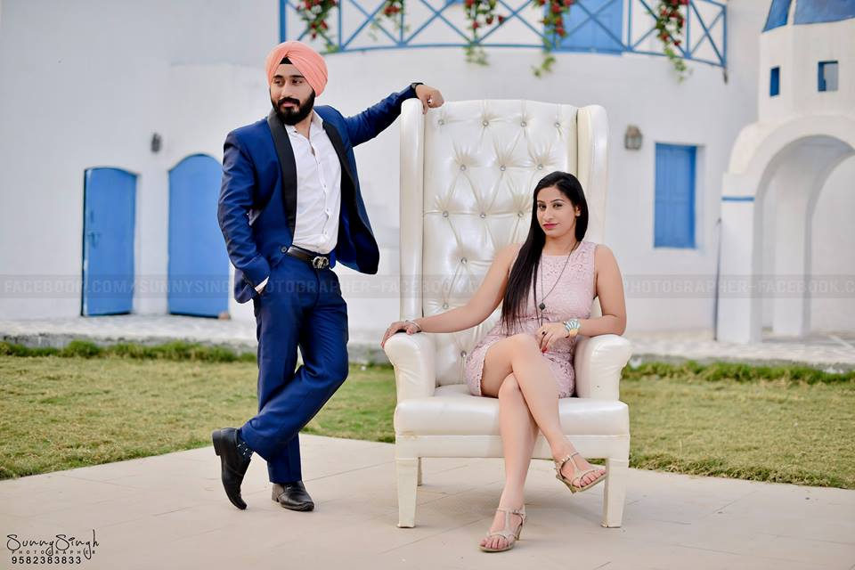 Sikh couple with blue coat and peach pagg and bride wearing peach dress at Your Dream Location Pre Wedding Photoshoot of couple with fairy lights at Your Dream Location | 5 Spectacular Photo Shoot Locations in Delhi NCR | FunctionMania