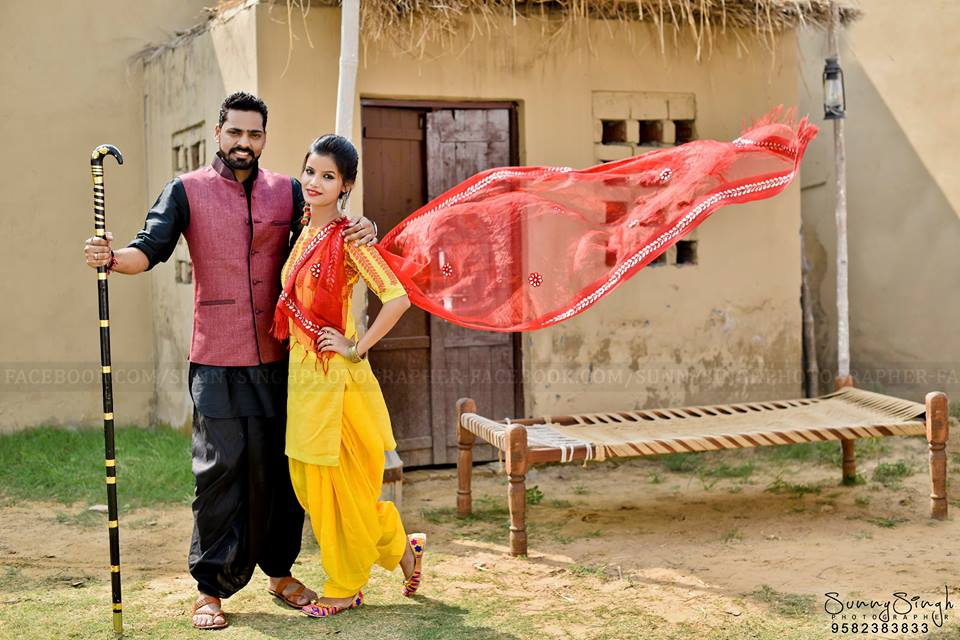 Punjabi Couple photoshoot at Your Dream Location in yellow salwar kameez and red dupatta with chaarpai | 5 Spectacular Photo Shoot Locations in Delhi NCR | FunctionMania