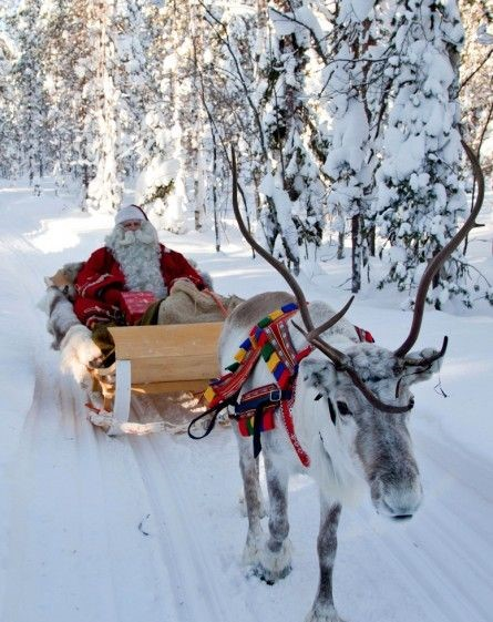 Santa Claus in Rovaniemi with a reindeer