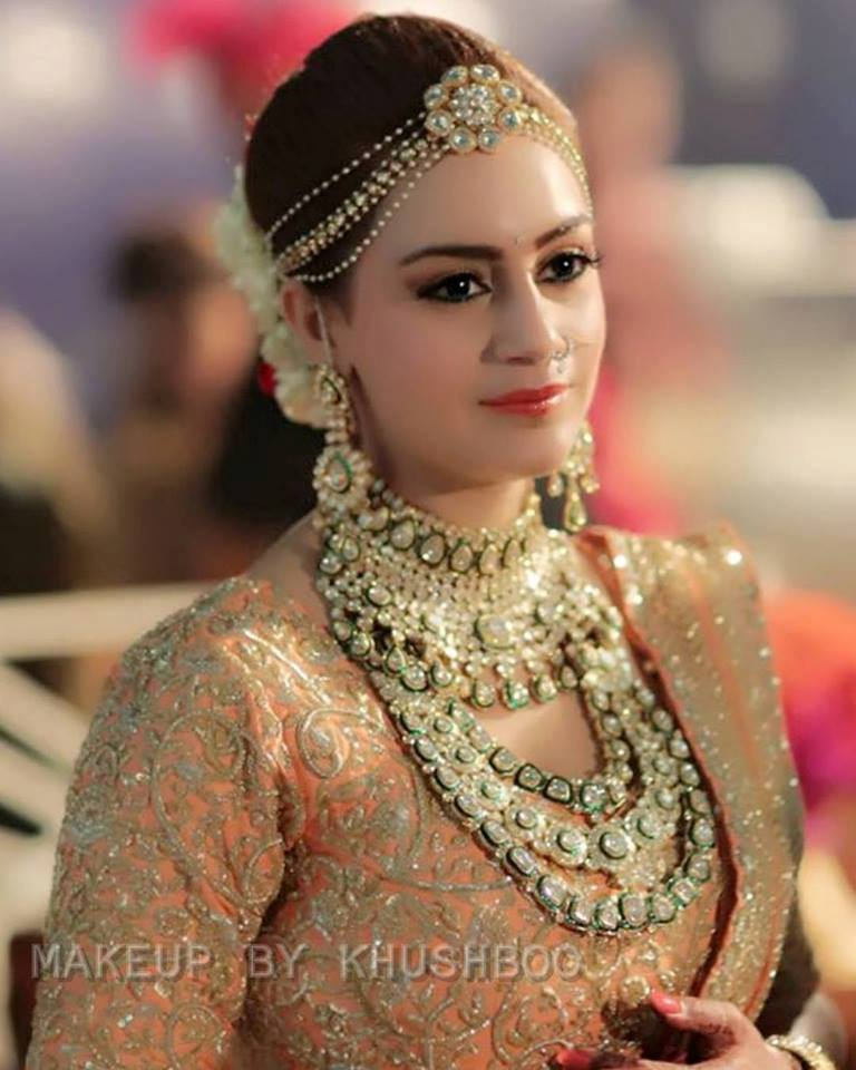 Minimalistic and Classy Makeup and Hairdo for an Indian Bride in Peach Lehenga and Bold Gemstones