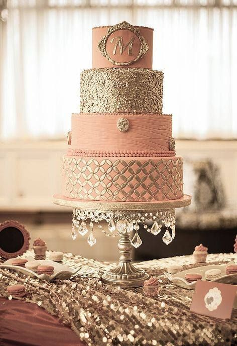 salmon-pink cake with glittery golden decorations