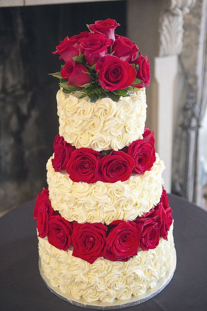 Beautiful white and red floral wedding cake