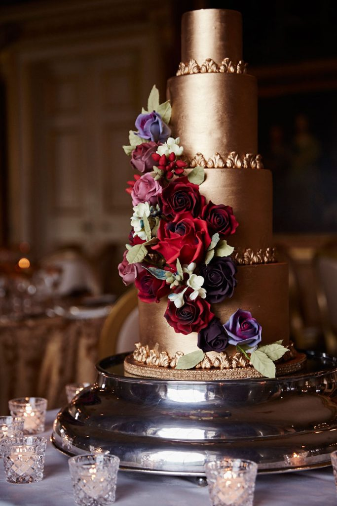 4-tiers tall, the gold finish and cascading roses cake