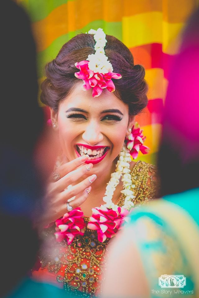 Smiling Pose for a Bride for Mehendi Ceremony-Function Mania- Story Weavers