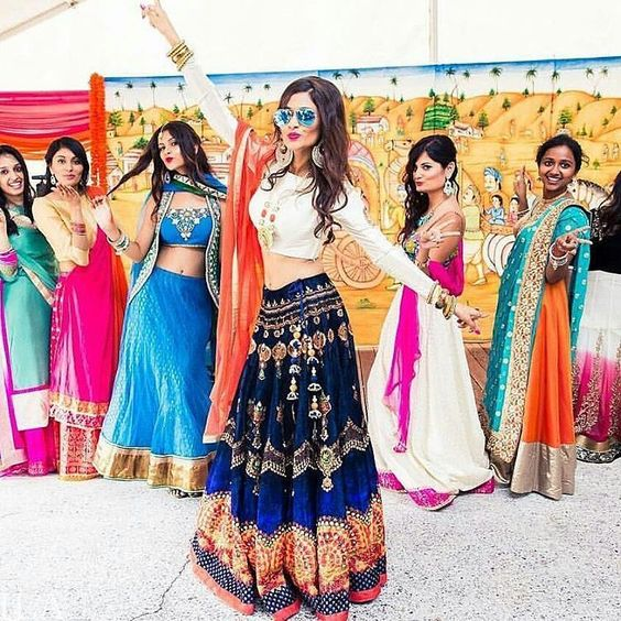 Bridesmaids Posing Confidently for a picture at an Indian wedding in Multicoloured Traditional Wear-Function Mania