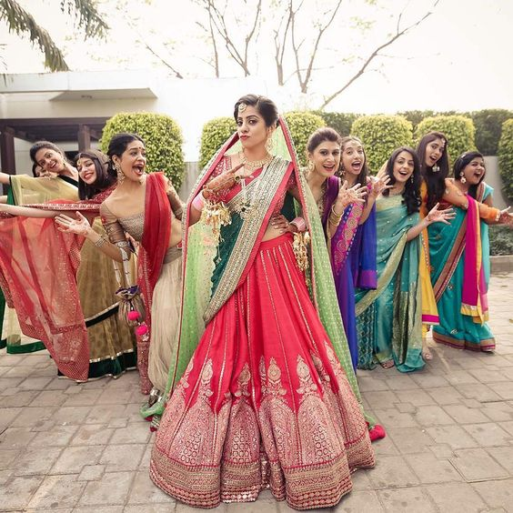 Quirky Poses for an India bride with here bridesmaids in a varied coloured dresses- Function Mania