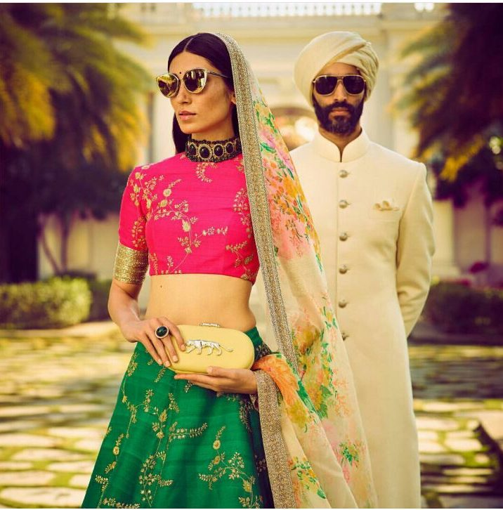 Sabyasachi Spring Summer 2018 Collection   Function Mania   Pink Blouse and Green Lehenga skirt with Printed Floral Dupatta for weddings   Black Stone Choker for Accessorizing a Wedding look   How to wear sunglasses on traditional wear   Sabyasachi Clutch   Off white bandhgala by Sabyasachi for grooms   Summer wedding groomwear ideas for men   bridal wear ideas   mehendi outfit for weddings   Wedding Outfit Goals   Sabysachi Bridal wear   Sabyaschi Groom Wear