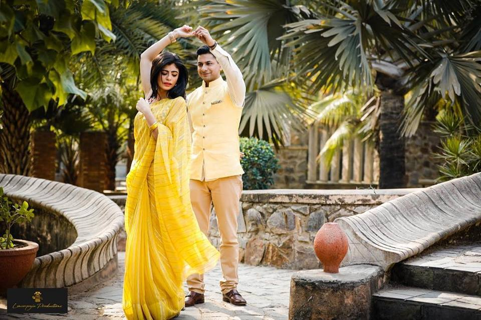 Pre wedding shoot ideas couple in yellow posing for a prewedding picture bride