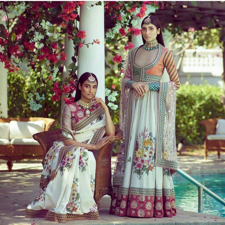 white saree with floral print in multi colours   magenta blouse and lehenga border at the bottom   Garden Print on Saree   Amritsari Maang Teeka   White Anarkali by Sabyasachi   Wedding wear   bridesmaids wear   Indian Wedding Wear   function Mania   Spring Summer 2018 Collection by sabysachi