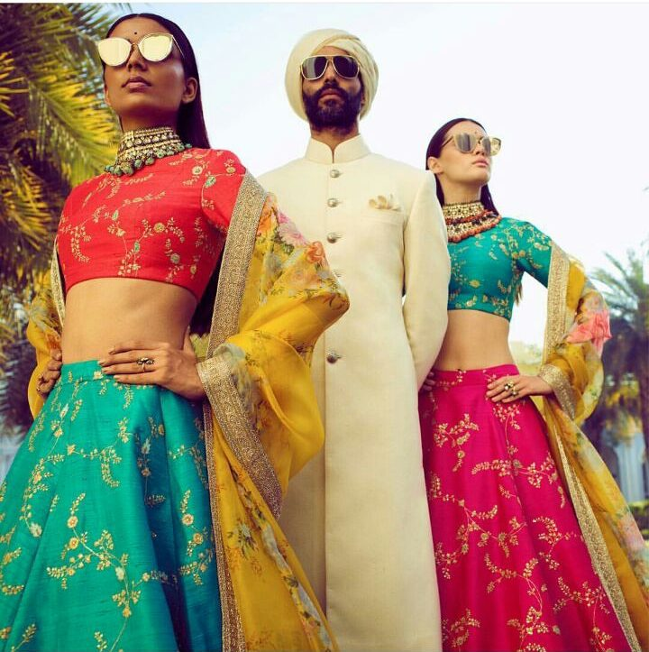 Orange Blouse on Turquoise lehenga with beautiful embroidery   cheet dupatta by Sabyasachi   Pop of Colours in Indian Wedding Wear   Yellow Dupatta with Lehenga Choli   Turquoise Blouse and Pink Lehenga with Cadmium yellow Cheet Dupatta   sabyasachi spring summer 2018   Function Mania   White Bhandhgala by sabyasachi for grooms and groomsmen   Wedding Guest Outfit Ideas   Indian Wedding Wear   Polki Chokers   Glares on Indian Wear   How to wear sunglasses on Traditional wear   Vintage Vibes in Sabyasachi   Pop of colour   bridal wear ideas    Summer Wedding outfit ideas