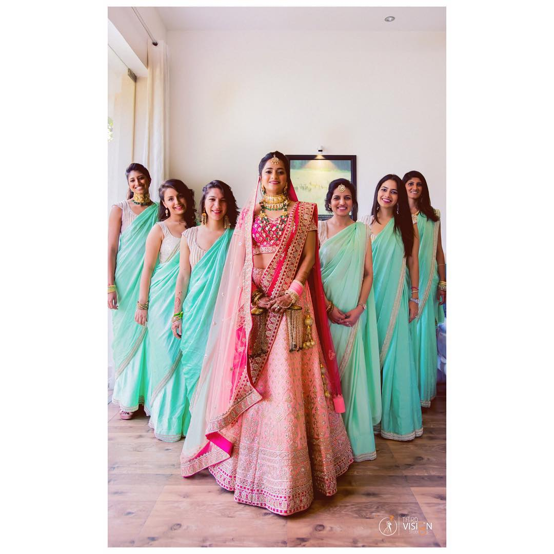 Bride with Bridesmaids Photo Ideas | Bride in Pink Lehenga with her bridesmaids in aqua blue sarees for an Indian Wedding | Thrid Vision Studio | Indian Bridesmaids Photo Ideas | Function Mania