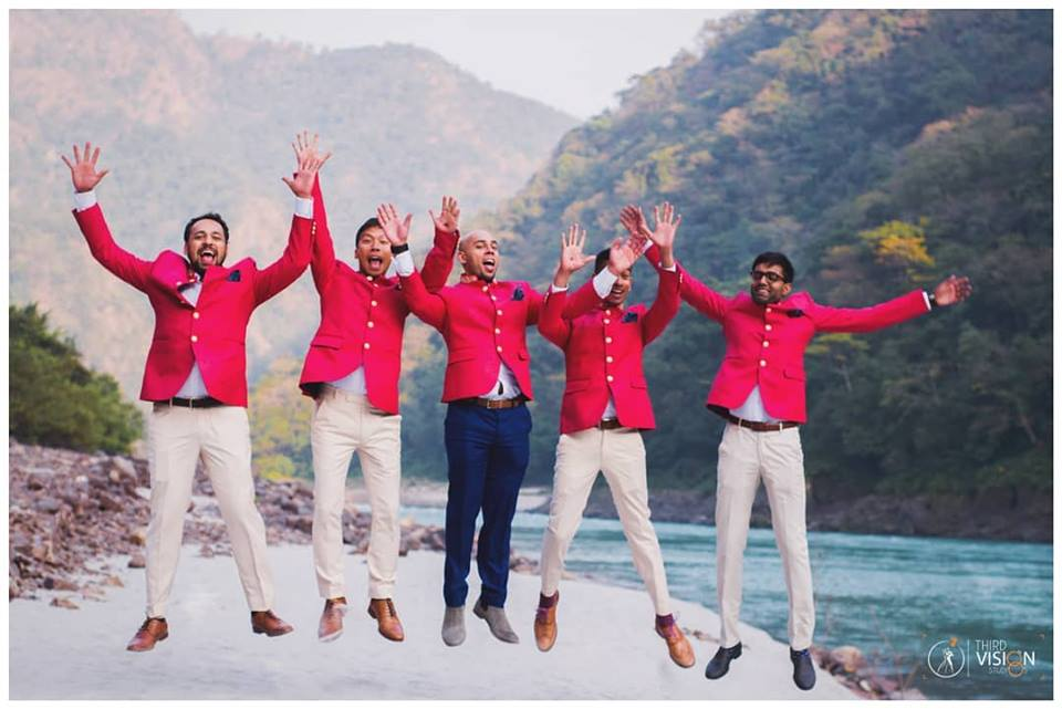 groomsmen in red bandhgalas jumping for a candid picture | wedding picture ideas | candid wedding Photography | beachside wedding photography ideas | Best indian wedding photograper | Third Vision Studio | Function Mania