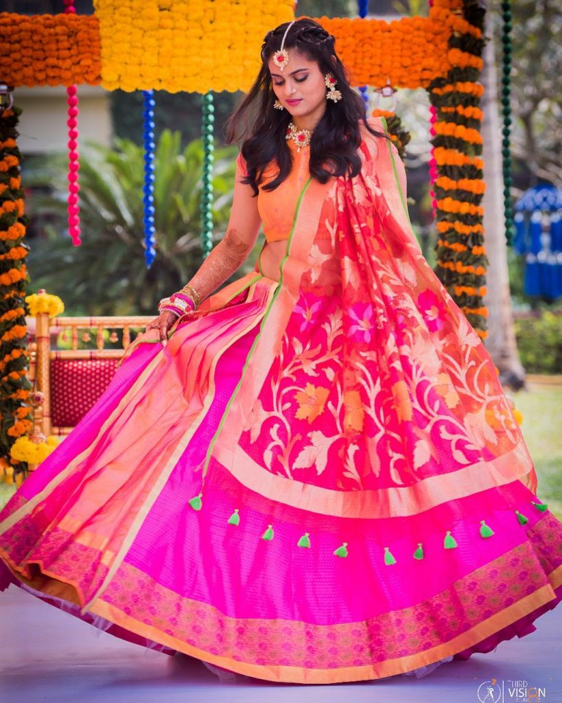 Indian Bride Twirling in a Hot pink and Orange lehenga | Mehendi Pictures | bridal portarit ideas | Indian Brides | Gota jewellery | Beautiful bridal Shots | Third Vision Studio | Function Mania