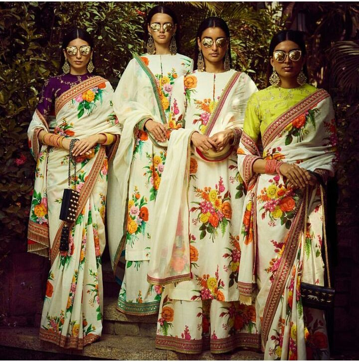 Printed in fine khadi to create languid kurtas and sarees embellished with 'tilla' borders. Combined with reflective sunnies, shimmering skin and dangling chandbalis, they evoke a potent and sexual image of a tropical summer.   Sabyasachi Wedding collection   wedding fashion   Indian Weddign Fashion   Summer Wedding FAshion   Sabyasachi Spring Summer 2018 Collection  Function Mania