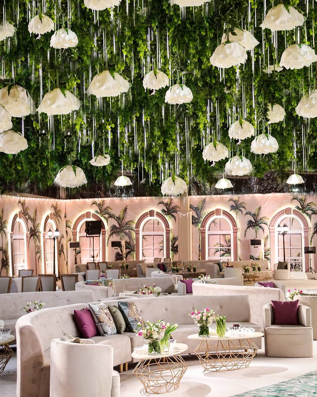 Stunning Ceiling Decor Ideas You Can Steal For Your Wedding!| beautiful green ceiling decor enamoured with huge inverted white fake floral embellishments | Ceiling decor ideas | Function Mania | White Floral Decor ideas | Wedding Reception Decor Ideas | Luxury Wedding Decor IDeas | Beautiful Decor Ideas