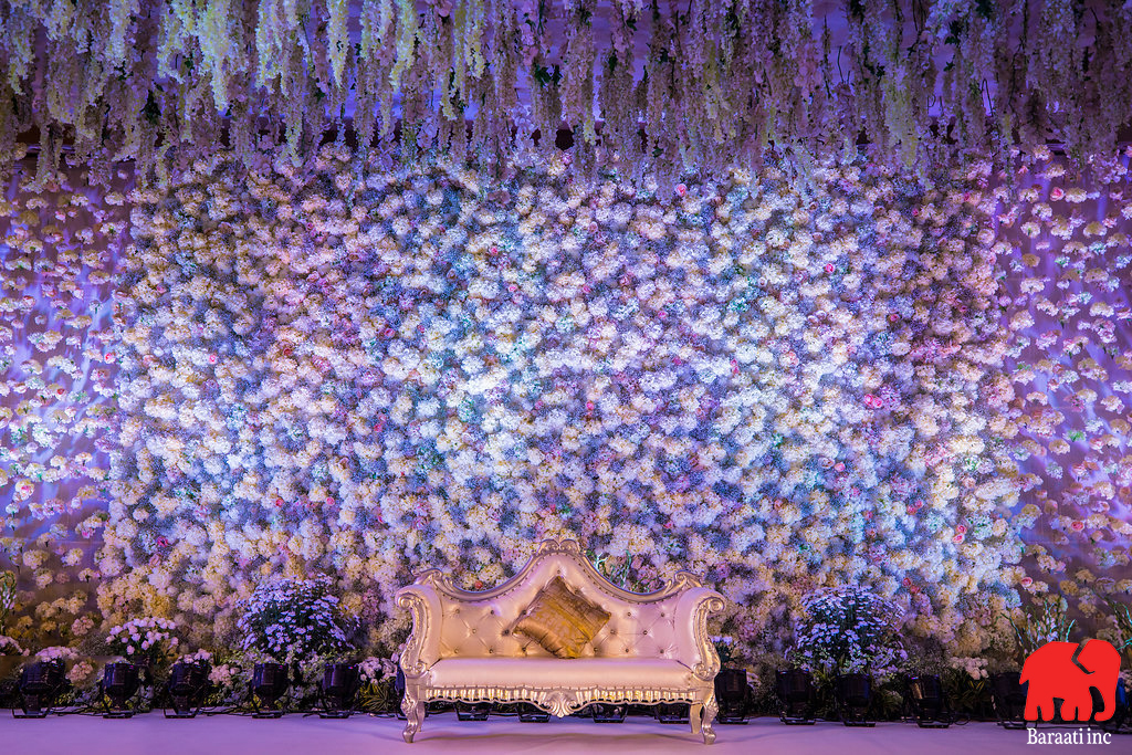 White floral stage backdrop, with lush white hanging floral ceiling decor | A Plush Start-Studded Wedding Reception With Stunning Ceiling Decor | Function Mania | Ramya weds Rahul | When a Bengali Groom gets married the telugu way | Indian wedding | Intercultural weddings are the best | Indian wedding decor | Gorgeous wedding decor | Gorgeous ceiling decor \ white ceiling decor | Indian wedding decoration ideas | Hyderabadi weddings |