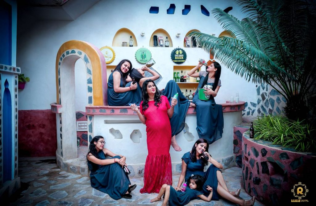 Bridesmaids posing with a drunk pose for a funny maternity photoshoot