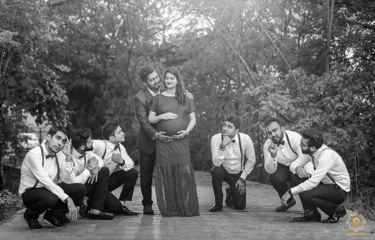 black and white maternity photoshoot with groomsmen/best men