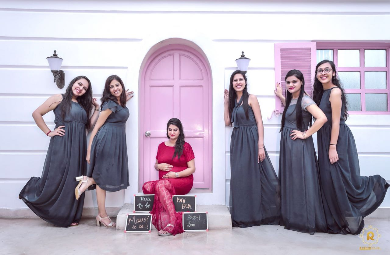 Bridesmaids posing with expecting mother for a unique maternity shoot