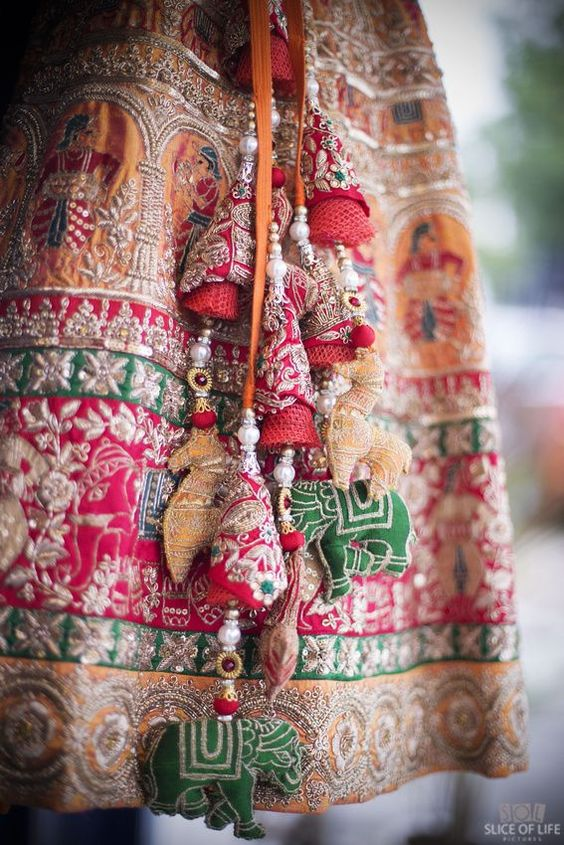Matching Tassels With Animal Motifs for a Heavily Embroidered Lehenga!