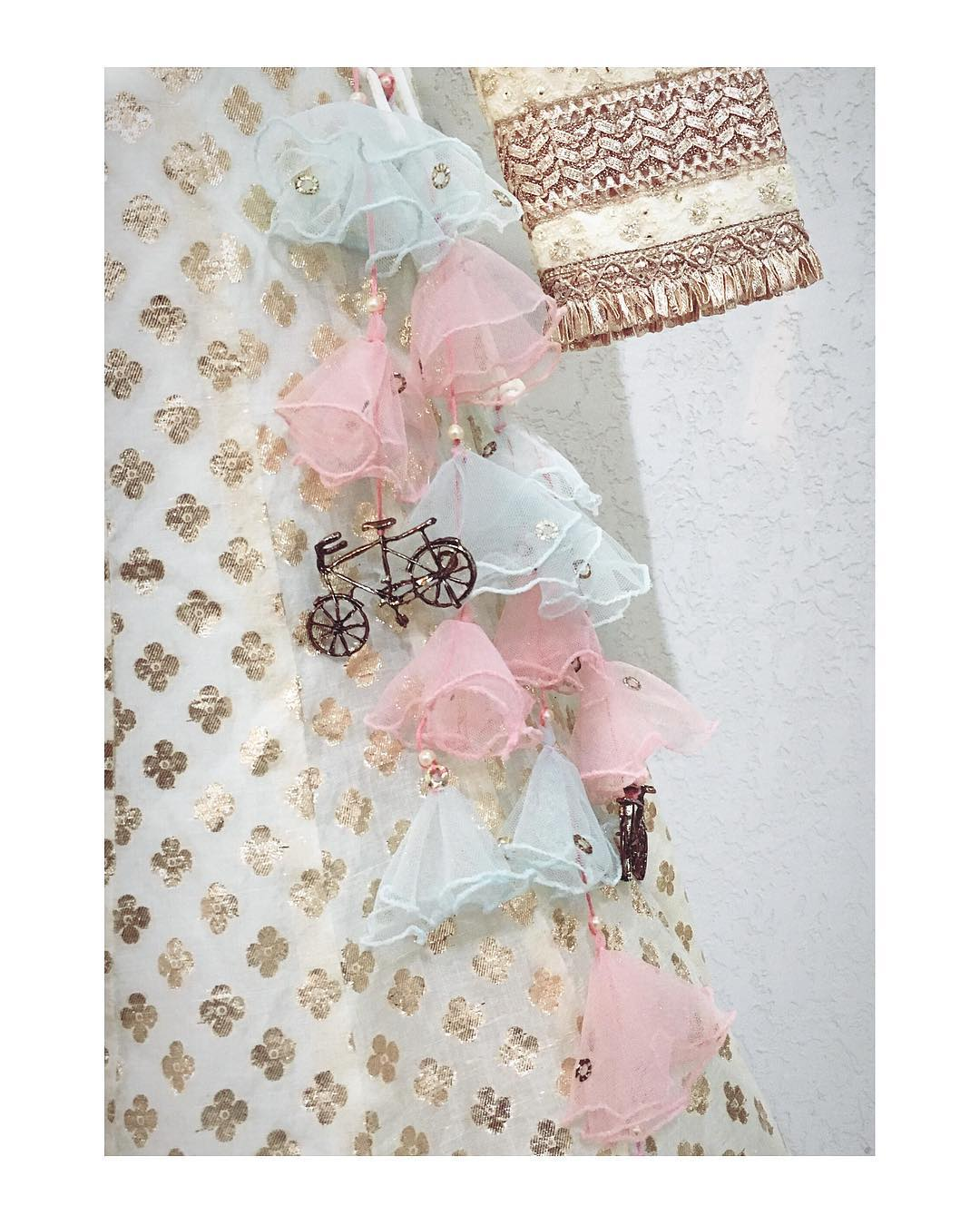 light and funky latkan with tulle inverted layers and tiny brass cycle