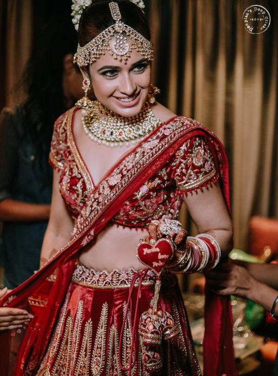 Yuvika Chaudhary went for Personalised tassels for bridal lehenga with bride's and groom's name!