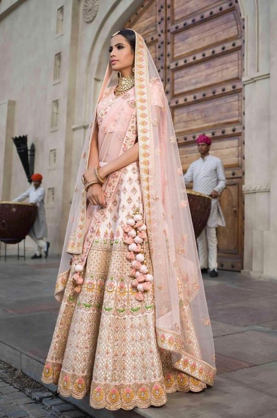 Colour Coordinated Pom Pom Latkans for a classy bridal look!
