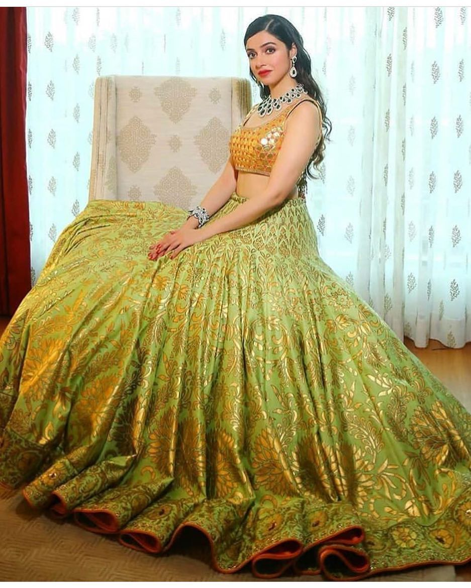 gorgeous olive green lehenga with yellow blouse top