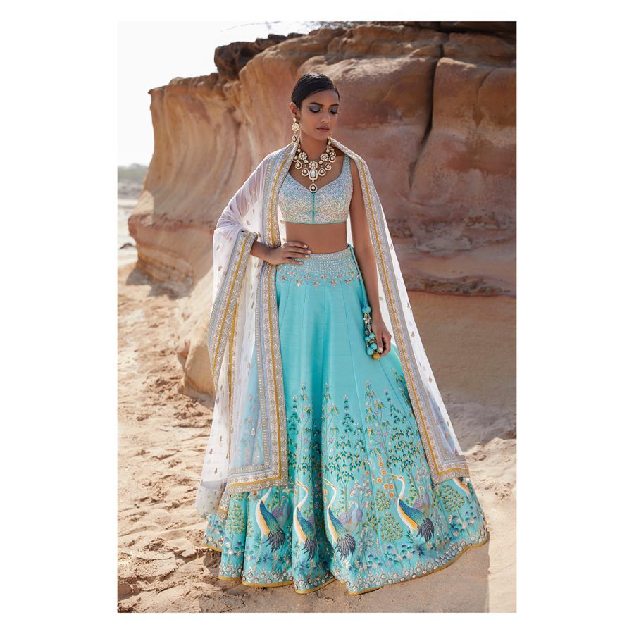 Hand-painted in traditional Rajasthani Picchwai style, soft-tone blue wedding lehenga for bridesmaids